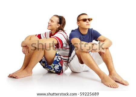 Couple sitting and resting. isolated over white - stock photo