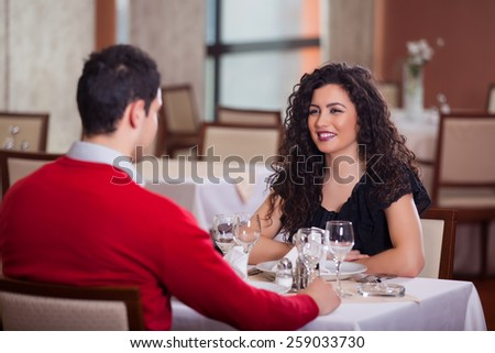 couple sitting at the table in restaurant