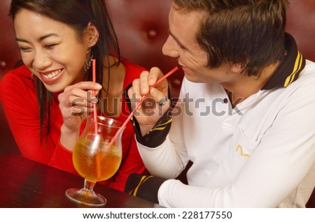 Couple sitting in a bar - stock photo