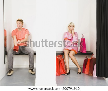 Couple sitting in shop's fitting room