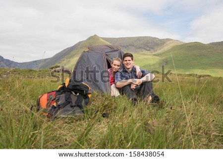 Couple sitting in their tent after a hike in the wilderness