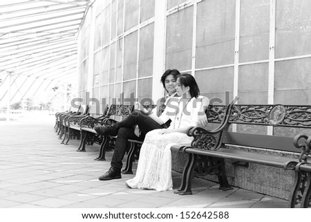 Couple sitting on the chair - stock photo
