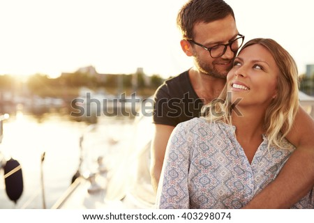 Couple Sitting on Their Boat Enjoying Life While In Love - stock photo