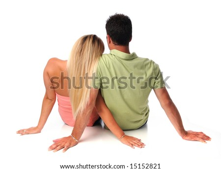 Couple sitting together isolated over a white background - stock photo