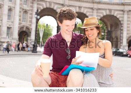 couple sitting together reading paperwork