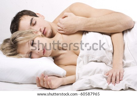 Couple sleeping together. Shallow depth of field with focus on the woman face. - stock photo