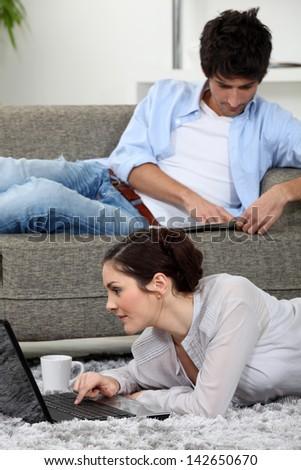 Couple slobbing around at home - stock photo