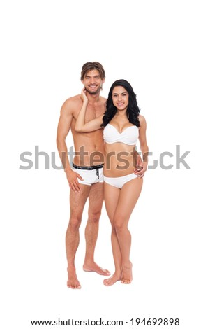 Couple smile wear swimsuit embrace, young man and woman tanned body swimwear full length isolated over white background