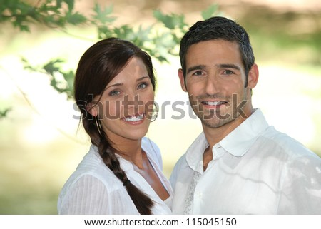 Couple smiling - stock photo