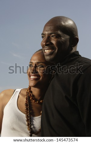 Couple smiling and hugging