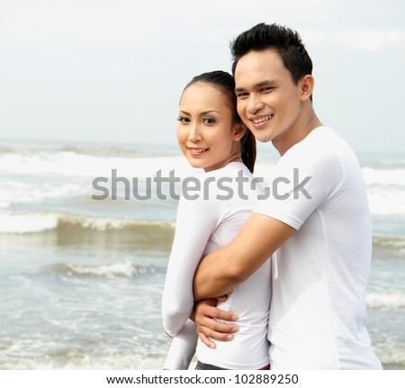 couple smiling on the beach