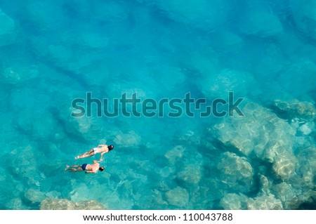 Couple snorkeling - stock photo