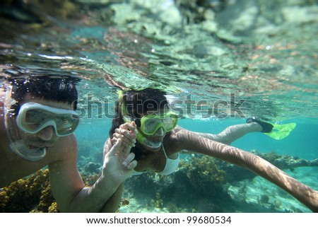 Couple snorkeling in Caribbean waters - stock photo