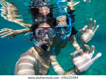 Couple snorkeling in Maldives - stock photo
