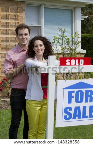 Couple sold home, vertical - stock photo