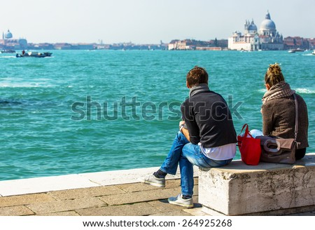 Couple standing by the Canal grande in Venice - stock photo