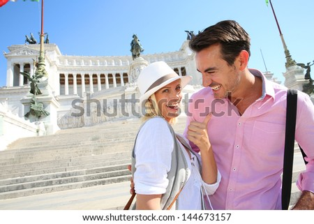 Couple standing by the monument of Emmanuel II in Rome