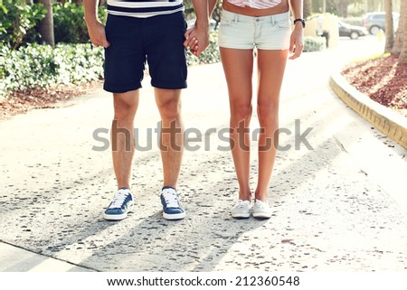 couple standing in the park and holding each others hand - stock photo