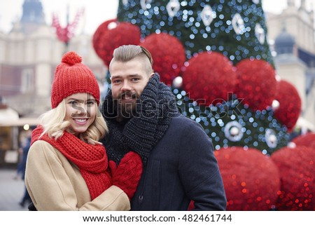 Couple standing next to the Christmas tree