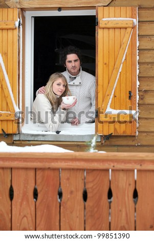 Couple staying in wooden chalet - stock photo