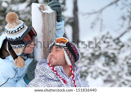 Couple stood in the ski-wear - stock photo
