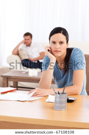 Couple sulking after doing their account together in the living room - stock photo