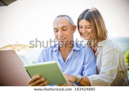 couple surfing on the web at resort -Stock - stock photo