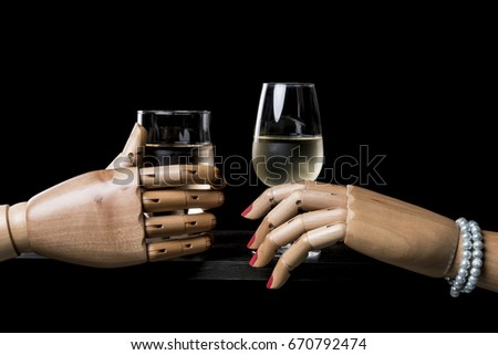 Couple takes a drink at the bar counter. Isolated on black background. With copy space text. Studio Shot.