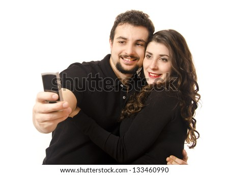 Couple taking a picture with the phone. (Latin -European ethnicity)