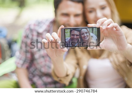 Couple taking a selfie in the forest