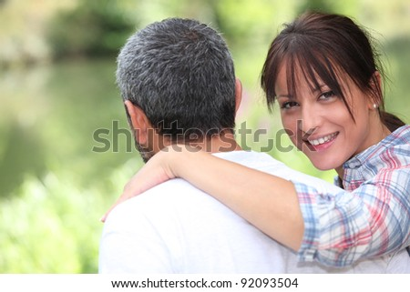Couple taking a walk in the park - stock photo