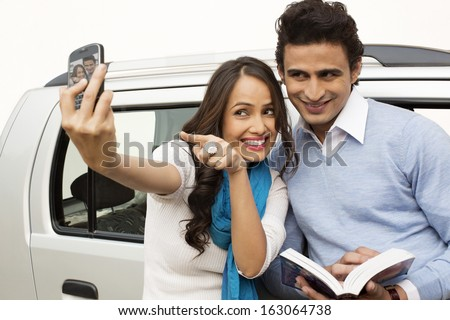 Couple taking picture of themselves with a mobile phone