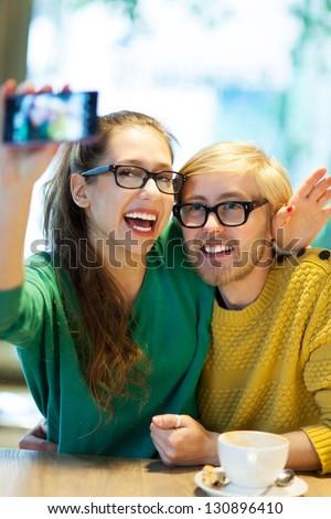 Couple taking self portrait - stock photo