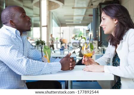 couple talking at the bar - stock photo