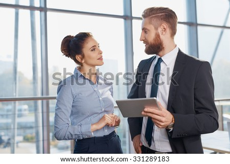 Couple talking during business meeting at modern office