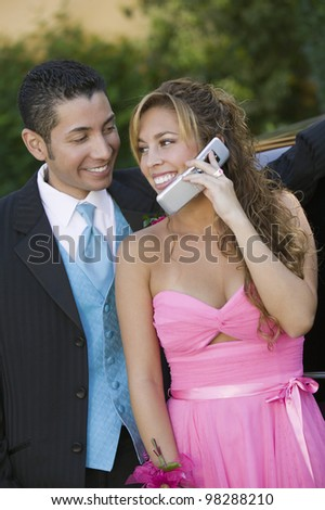Couple Talking on Cell Phone - stock photo