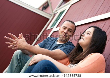 Couple Talking Together - Young happy couple enjoying each others company outdoors. - stock photo
