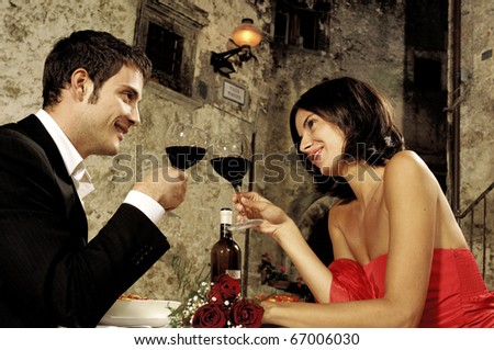 couple toasting at restaurant - stock photo