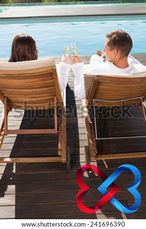 Couple toasting champagne by swimming pool against linking hearts - stock photo