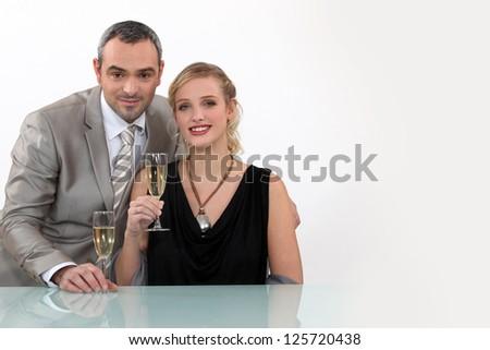 Couple toasting their anniversary - stock photo