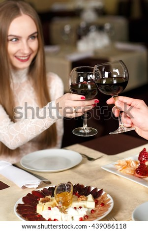 Couple toasting wineglasses  - stock photo