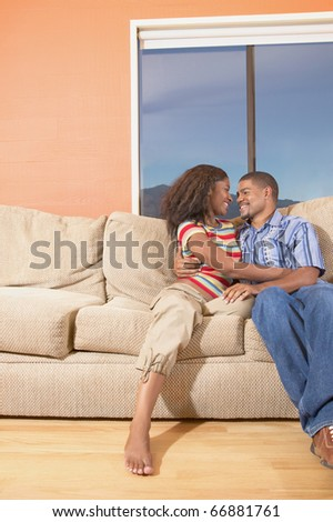 Couple together on couch - stock photo