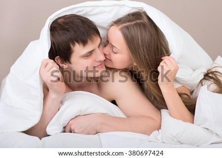 Couple under blanket - stock photo