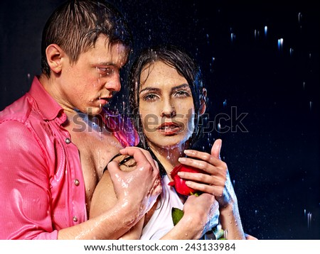 Couple  under  water drop. Valentine day - stock photo