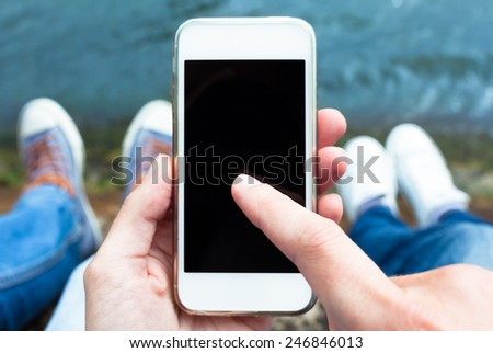 Couple using smart phone mobile