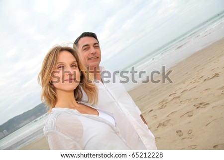 Couple walking by the beach - stock photo