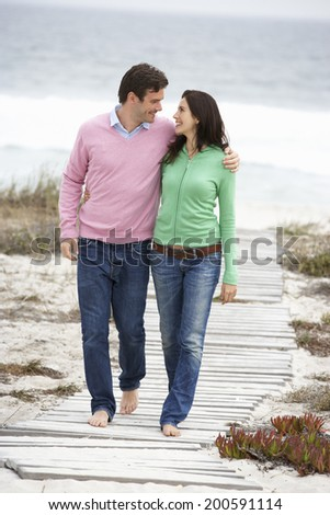Couple walking by the sea - stock photo