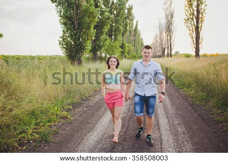 Couple walking holding hands in a park - Romantic date outdoors