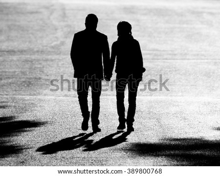 Couple walking in the park at sunrise