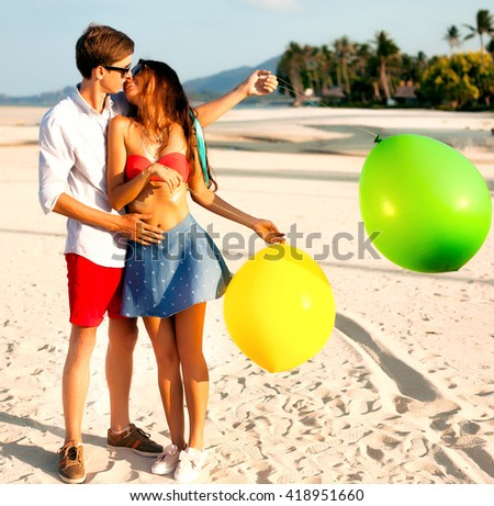 Couple walking on beach.Young happy interracial couple walking,smiling holding around each other. Asian woman,Caucasian man.enjoy their date,happy mood,funny people,handsome man,seductive woman - stock photo